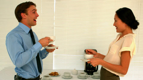 Business people having coffee in the staff room Footage