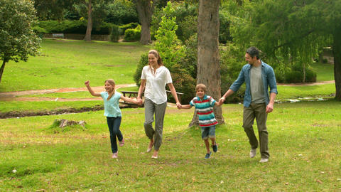 Happy Family Skipping In The Park stock footage