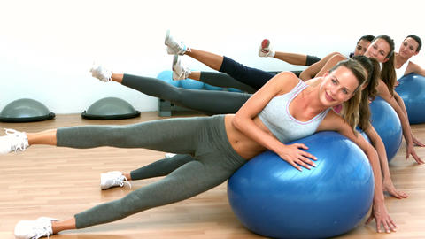Fitness class exercising on on exercise balls Live Action
