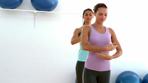 Fit brunettes doing pilates move in studio Footage