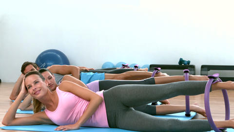 Fit women doing pilates together in studio Footage