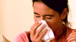 Sick girl sneezing Footage