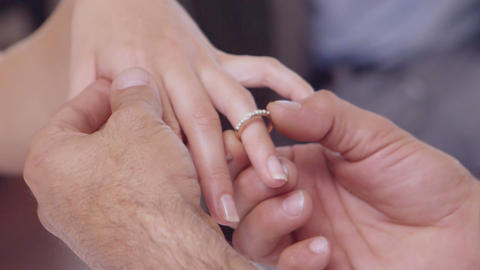 Man placing ring on womans finger Footage