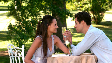 Couple having a romantic meal together outside Footage
