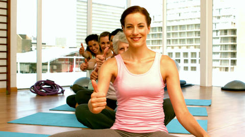 Group of women in fitness studio showing thumbs up Footage