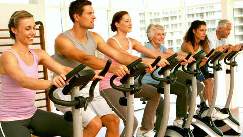 Happy spinning class in fitness studio Footage