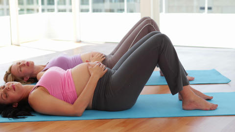 Pregnant women doing yoga in fitness studio Footage