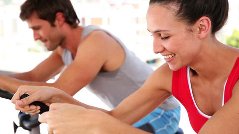 Fit couple working out on exercise bikes Footage