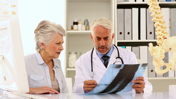Doctor Explaining A Spine Xray To Patient stock footage