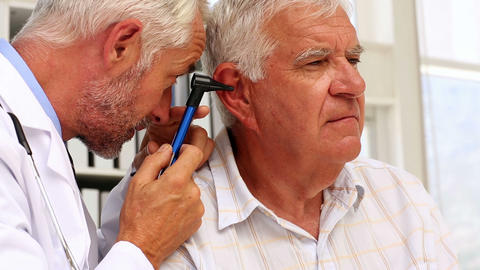 Doctor examining his patients ears Footage
