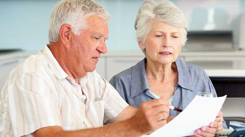Senior Couple Paying Their Bills stock footage