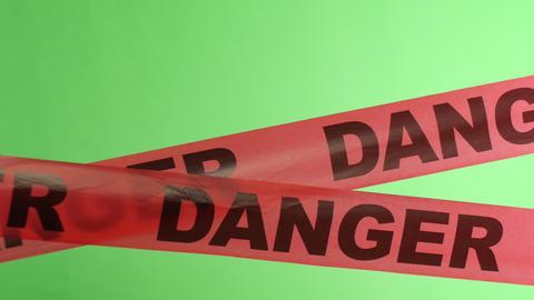 4K Moving Danger Warning Tape Overlay Green Screen stock footage