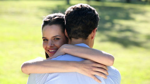 Happy couple embracing in the park Footage