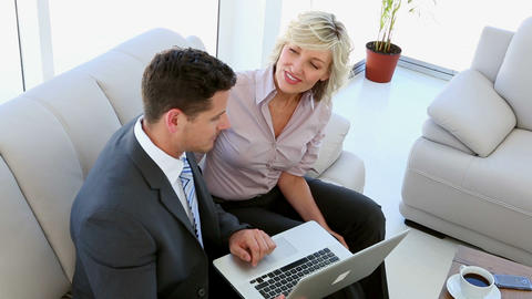 Business people working together on laptop Footage