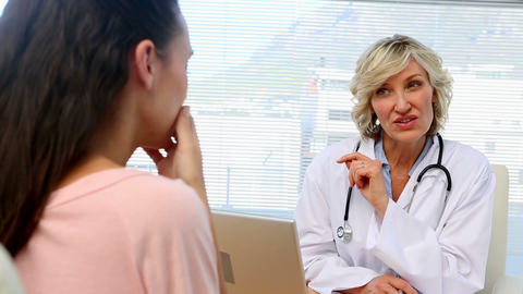 Blonde Doctor Giving Bad News To Her Patient stock footage