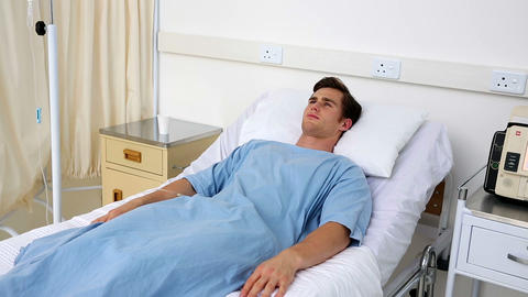 Sick Man Lying On Hospital Bed stock footage