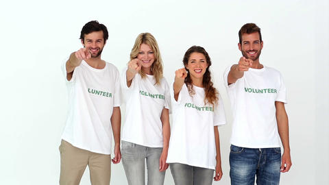Team of volunteers smiling at camera giving thumbs up Footage