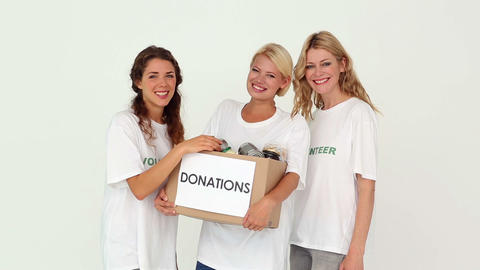 Team of volunteers holding donation box Footage