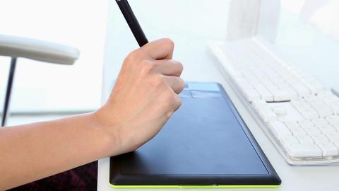 Graphic designer working on digitizer at her desk Footage