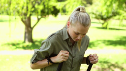Fit blonde stretching before a hike Footage