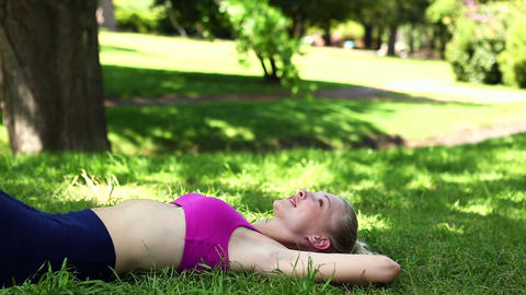Fit blonde lying on the grass Footage