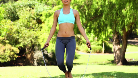 Fit asian girl jumping rope Footage