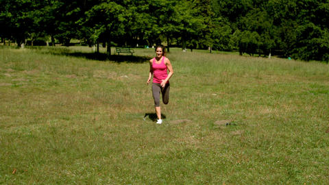 Fit woman sprinting towards camera Footage