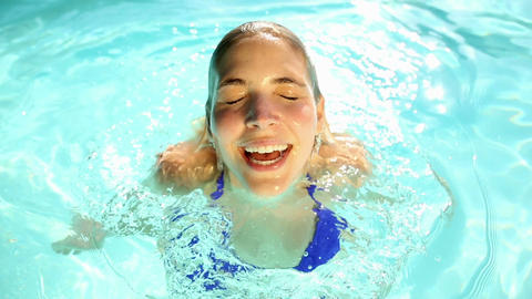 Pretty blonde swimming in a pool Footage