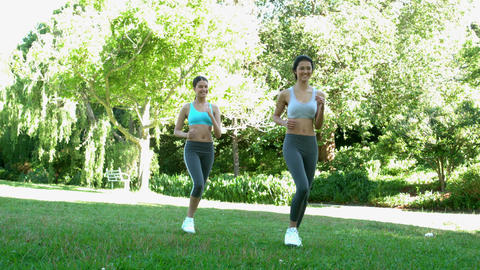 Fit friends running together in the park Footage