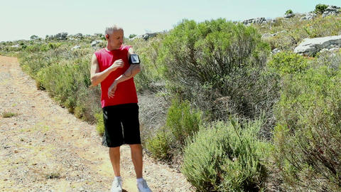 Man jogging through a wild terrain Footage