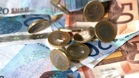 Euro coins dropping onto notes Footage