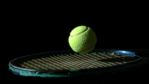 Tennis ball bouncing on a racket Footage