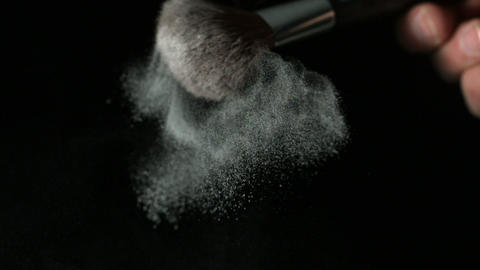 Powder dispersing from make up brush Footage