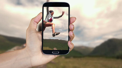 Hand showing running and adventure clips on smartphone Stock Video Footage