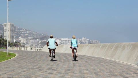Couple going for a bike ride by the seaside Live Action