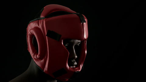 Tough boxer wearing red helmet Footage