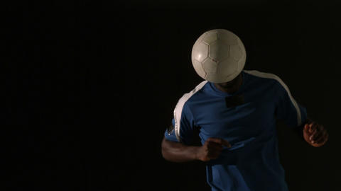Football player heading the ball Footage