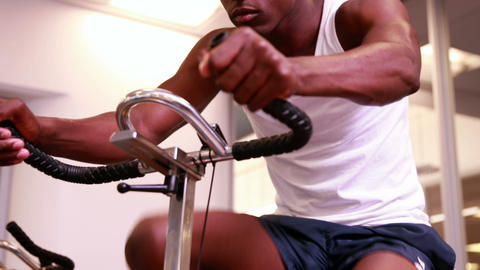 Fit man working out on the exercise bike Footage