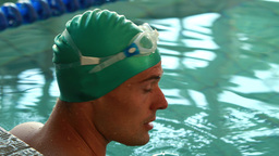 Fit swimmer smiling up at camera in the swimming pool Live Action