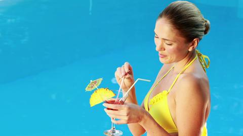 Gorgeous blonde in bikini enjoying a cocktail pool Footage