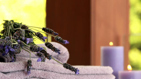 Dried lavender on purple towels Live Action