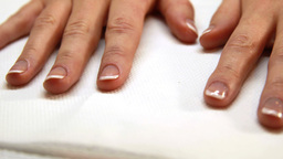 Hands showing fresh french manicure Live Action
