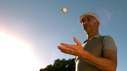 Golfer throwing and catching golf ball on the cour Footage