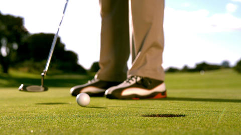 Golfer Putting The Ball On The Green stock footage