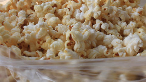 white popcorn containing in plastic bag Footage