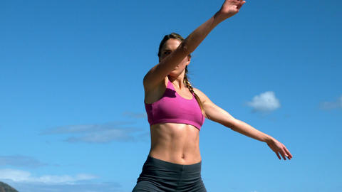 Fit blonde doing yoga on sunny day Footage