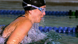Fit swimmer doing the butterfly stroke in swimming Footage