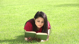 Woman Reading Outdoors Footage