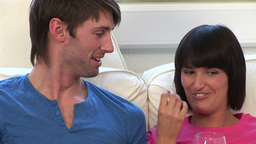 Young Couple Watching Television Footage