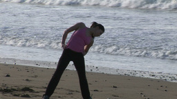 Woman Stretching on Beach Footage